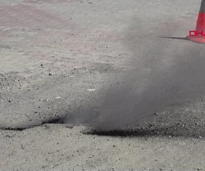 Yoldaki çatlaklardan çıkan duman paniğe neden oldu