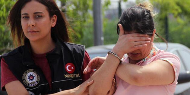 Kocasıyla birlikte tutuklanan kadın gözyaşlarını tutamadı