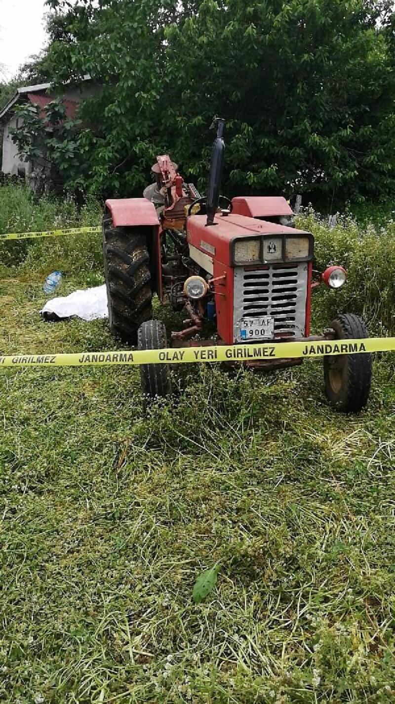 Traktöre bağlı ot biçme makinesine sıkışan çiftçi öldü