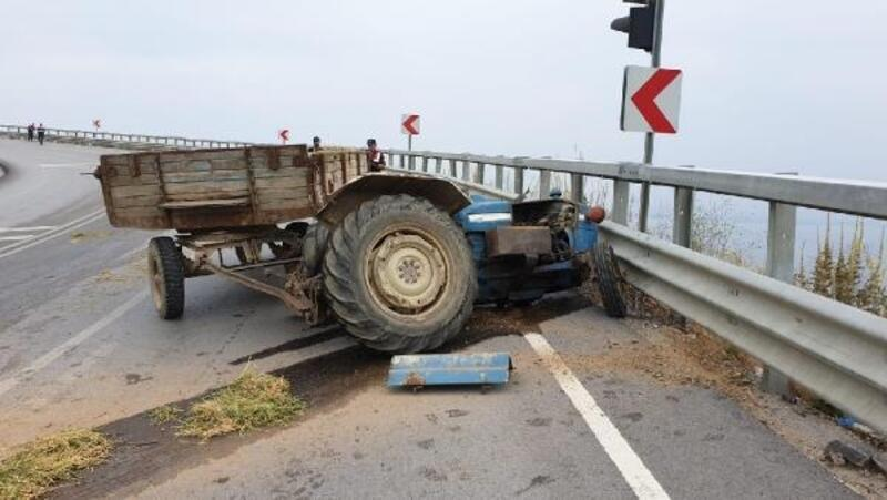 Devrilen traktörden fırlayan sürücü ağır yaralandı