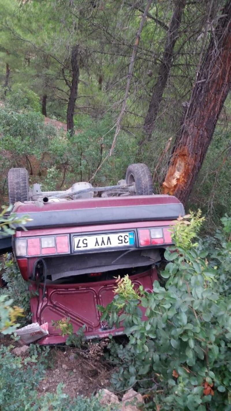 Şarampole yuvarlanan otomobildeki baba ve oğlu yaralandı